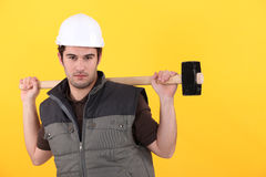 Worker with a sledgehammer Royalty Free Stock Photos