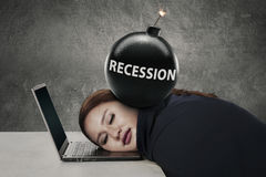 Worker sleeps on laptop with bomb recession Stock Image