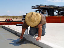 Worker Smoothing out a Concrete Slab Royalty Free Stock Photos