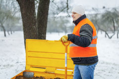 Worker with snow shovel in winter Royalty Free Stock Images