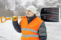 Worker with snow shovel in winter Royalty Free Stock Photography