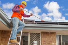 Worker and solar panels Stock Photos