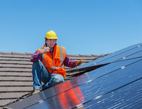 Worker and solar panels Royalty Free Stock Image