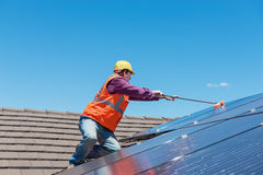 Worker and solar panels Stock Image