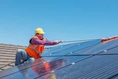 Worker and solar panels Royalty Free Stock Photography