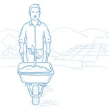 Worker of solar power plant with sprout in cart. Stock Photos