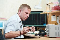 Worker soldering microchip scheme Royalty Free Stock Photos