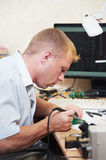 Worker soldering microchip scheme Royalty Free Stock Photography