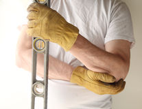 Worker with sore elbow Royalty Free Stock Images