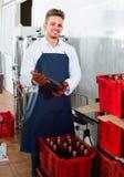 Worker sorting wine bottles stock photos