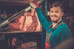 Worker in a spare parts warehouse Royalty Free Stock Image