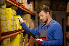 Worker in a spare parts warehouse Stock Photo