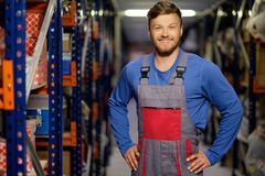 Worker in a spare parts warehouse Royalty Free Stock Photography