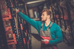 Worker in a spare parts warehouse Stock Photography