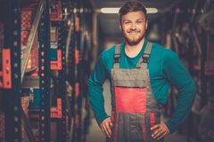 Worker in a spare parts warehouse Royalty Free Stock Photos