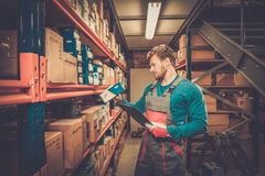 Worker in a spare parts warehouse Royalty Free Stock Images