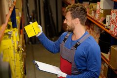 Worker in a spare parts warehouse Stock Image