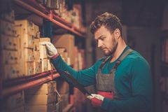 Worker in a spare parts warehouse Stock Photos