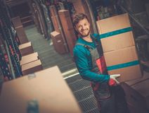 Worker in a spare parts warehouse Stock Images