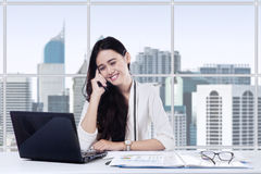 Worker speaking on the phone in office room Royalty Free Stock Images