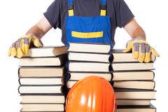 Worker Specialist With Many Books Royalty Free Stock Photography