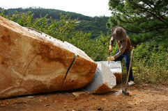 Worker split large rock  for road-works Royalty Free Stock Images