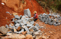 Worker split stone for road-works Royalty Free Stock Photography