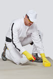 Worker sponge clean cement substrate Stock Images