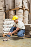 Worker with sprained ankle on the floor Royalty Free Stock Photo