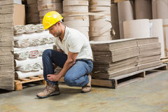 Worker with sprained ankle on the floor Royalty Free Stock Photos
