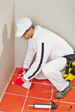 Worker sprayed silicone sealant Stock Image