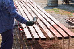 Worker spraying steel bar royalty free stock photography