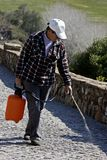 Worker spraying the street. In Portugal Royalty Free Stock Image