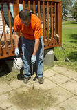 Worker Spraying Weed Killer On A Old Patio Stock Photo