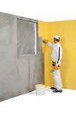 Worker spreading a plaster on a corner-wall Royalty Free Stock Photos