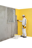 Worker spreading a plaster on a corner-wall Stock Photography