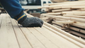 Worker stacking square wooden chips at wood industry stock video footage