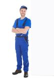 Worker standing arms crossed while leaning over white background Stock Images