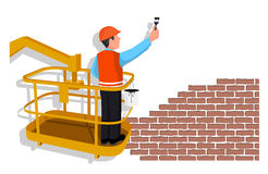 Worker standing in an assembly cradle paints a wall representing the place for your text. Royalty Free Stock Images
