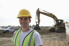 Worker Standing At Construction Site Stock Photo