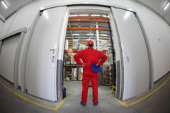 Warehousing - worker standing in doorway Royalty Free Stock Image