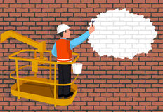 Worker standing on a ladder paints a wall representing the place for your text. Stock Photos