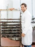 Worker Standing By Rack Of Beef Jerky At Shop Stock Photos