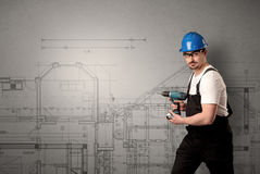 Worker with technical drawing. Royalty Free Stock Photo