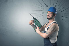 Worker standing with tool. Stock Image