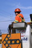 Worker stands in aerial lift bucket Royalty Free Stock Photos