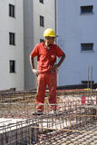 Worker Stands Among Rebar - Vertical Royalty Free Stock Photos