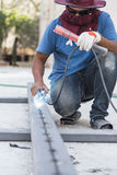 Worker steel welding with unsafety position Stock Image