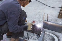 Worker steel welding with unsafety position Stock Photo