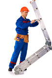 Worker with step-ladder Stock Photo